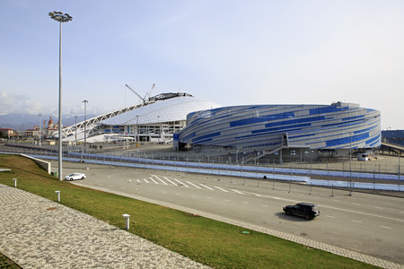 fisht: Sochi, Russia - February 15, 2015: Shayba Arena for a hockey puck and Fisht Olympic Stadium in Adler