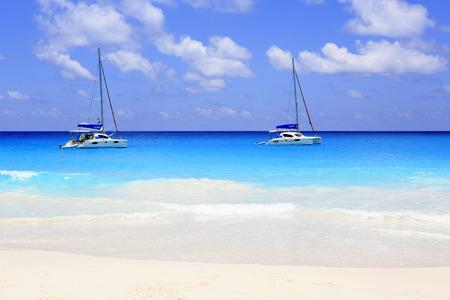 praslin: Praslin Island, Seychelles - March 10, 2015: Yacht in the Indian Ocean on the beach Anse Georgette. Editorial