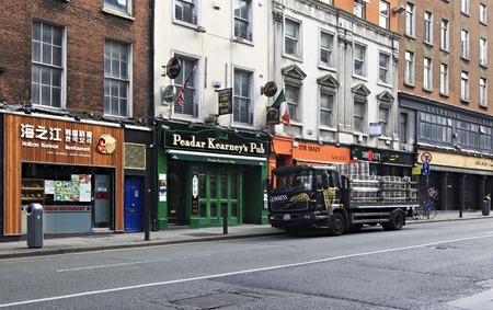 city centre: Dublin, Ireland - August 20, 2014: Truck loaded with barrels of beer Guinness at the bar in Dublin.