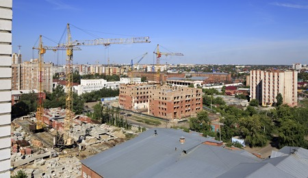 uncompleted: Omsk, Russia - August 17, 2013: Construction of high-rise apartment brick building.
