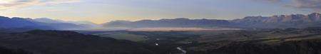 north ridge: Panorama of Kuray mountain range and North Chuya ridge at the dawn. Stock Photo