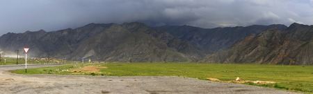 altai mountains: Storm clouds over the North Chuya ridge of Altai Mountains.