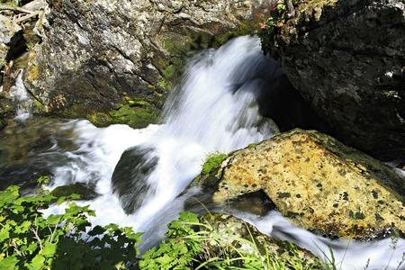 chemal: Movement of water in Muehtinsky waterfall. Altai Republic.