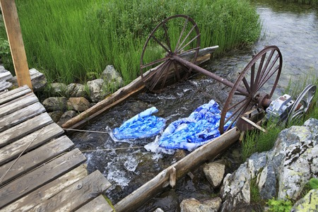 western slope: Adaptation for washing linen in a mountain river. Republic of Altai.
