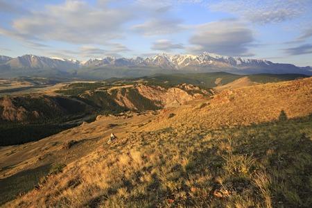 north ridge: Kurai steppe and North Chuya ridge at the dawn. Stock Photo