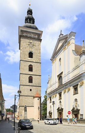 budweis: Budejovice, Czech Republic - July 3, 2013: Black Tower and St. Nicholas Cathedral in Ceske Budejovice