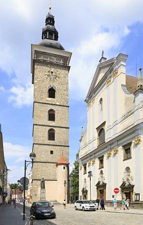 Budejovice, Czech Republic - July 3, 2013: Black Tower and St. Nicholas Cathedral in Ceske Budejovice
