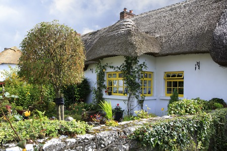 nineteenth: Adare, Ireland - August 25, 2014: Houses with thatched roof of the first half of the nineteenth century