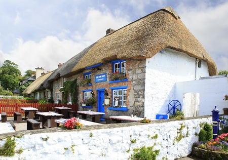 Adare, Ireland - August 25, 2014: Houses with thatched roof of the first half of the nineteenth century