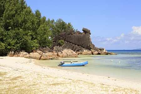 ladigue: Boat at the beautiful beach of Curieuse Island in the Indian Ocean. Stock Photo