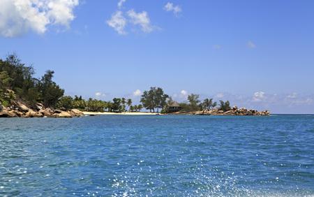 ladigue: Praslin Island, Seychelles - March 11, 2015: Beach at the Constance Lemuria Resort. Praslin Island in the Seychelles. Editorial