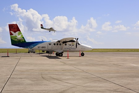 tranquil: Mahe Island, Seychelles - March 13, 2015: Planes local airlines at Seychelles International Airport on Mahe Island.