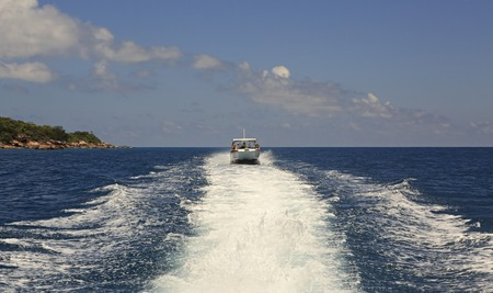ladigue: Praslin Island, Seychelles - March 11, 2015: Tourist boat in the Indian Ocean. Editorial