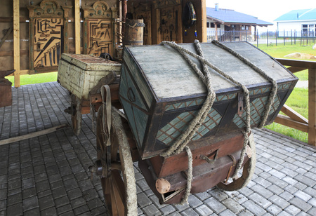 woodland sculpture: Novotyryshkino, Russia - July 31, 2013: Cart with the old trunk. Peasant Museum in Tourist Complex Siberian Podvorye. Editorial