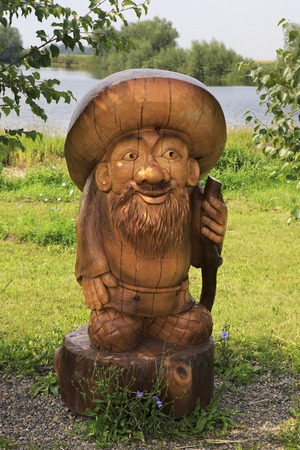 woodland sculpture: Novotyryshkino, Russia - July 31, 2013: Old man Borovichok. Wooden sculptures based on Pushkins fairy tales. Tourist Complex Siberian Podvorye.