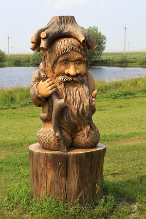 woodland sculpture: Novotyryshkino, Russia - July 31, 2013: Wood goblin. Wooden sculptures based on Pushkins fairy tales. Tourist Complex Siberian Podvorye.