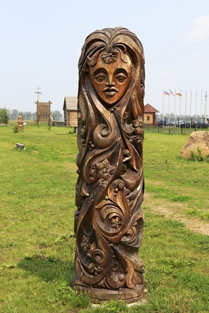 woodland sculpture: Novotyryshkino, Russia - July 31, 2013: Wooden sculptures based on Pushkins fairy tales. Tourist Complex Siberian Podvorye. Editorial