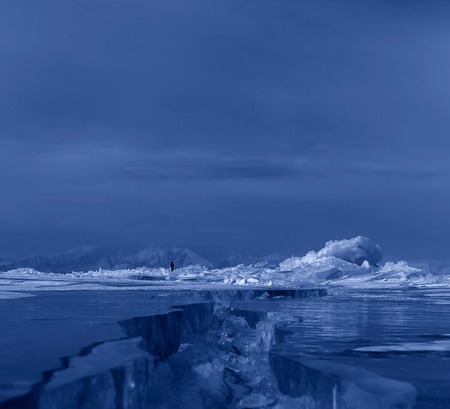 cracks in ice: Large cracks on surface of the ice. Beautiful winter landscape in the Lake Baikal.