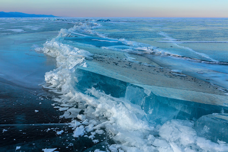 Large blocks of ice crack. Beautiful winter landscape in the Lake Baikal. Фото со стока - 56449613