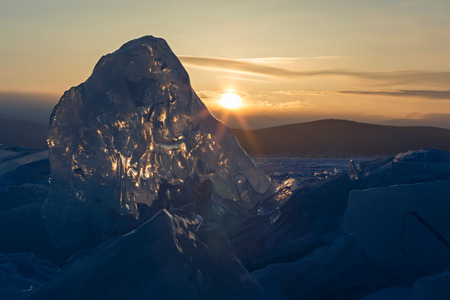 ice floes: Sun rises over the ice floes. Beautiful winter landscape in the Lake Baikal.