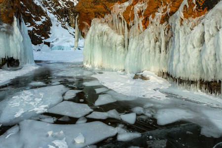 ice floes: White ice floes in transparent and frost on the rocks. Beautiful winter landscape in the Lake Baikal.