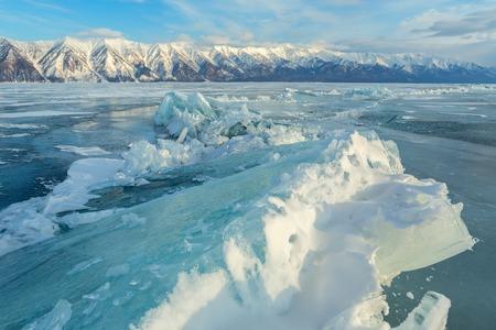 Large blocks of ice crack. Beautiful winter landscape in the Lake Baikal.