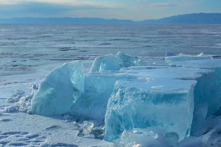 Huge blocks of ice. Beautiful winter landscape in the Lake Baikal. Stock Photo