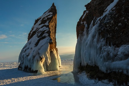 ice covered: Ice covered rocks near island Lohmaty. Beautiful winter landscape in the Lake Baikal.