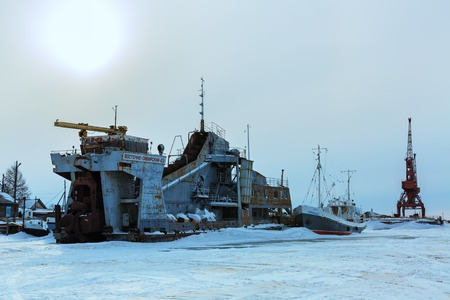 hummock: Ust-Barguzin, Russia - March 04, 2016: Pier on the shore of Lake Baikal in winter evening. Editorial