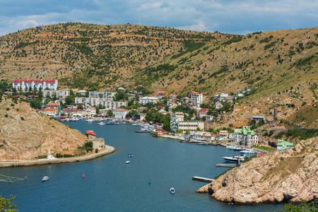 Balaklava is a popular Crimean resort. Balaklava bay former submarine base. Stock Photo