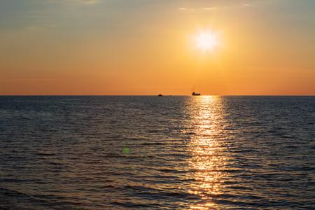 setting  sun: Beautiful reflection of rays setting sun in the Black Sea. Sevastopol, Crimea. Russia