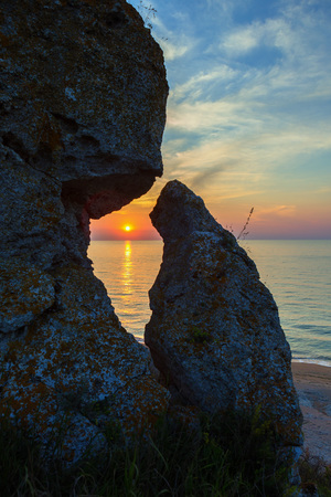 Sunset over the Sea of Azov on Generals beach. Karalar regional landscape park in the Crimea.