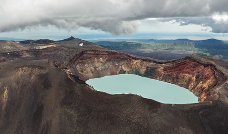 acidic: Maly Semyachik is a stratovolcano with acidic crater lake. Kronotsky Nature Reserve on Kamchatka Peninsula. View from helicopter.