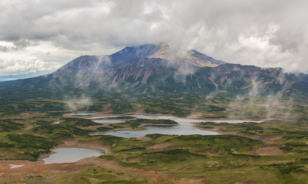 Uzon Caldera in Kronotsky Nature Reserve on Kamchatka Peninsula. View from helicopter. Stock Photo