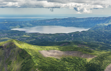 hot temper: Crater Karymsky Lake. Kronotsky Nature Reserve on Kamchatka Peninsula. View from helicopter.