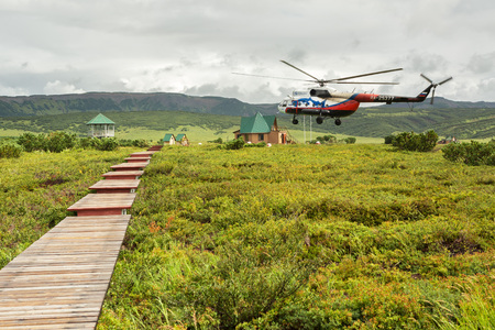 hot temper: Kamchatka Peninsula, Russia - August 12, 2016: Helicopter landed in the Uzon Caldera. Kronotsky Nature Reserve on Kamchatka Peninsula. Editorial