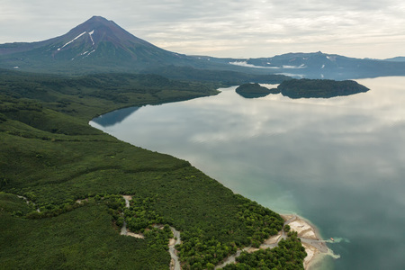 Kurile lake and Ilyinsky volcano. South Kamchatka Nature Park. View from the helicopter.