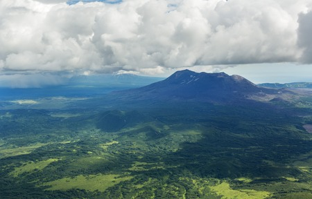 hot temper: Maly Semyachik is a stratovolcano. Kronotsky Nature Reserve on Kamchatka Peninsula. View from helicopter.