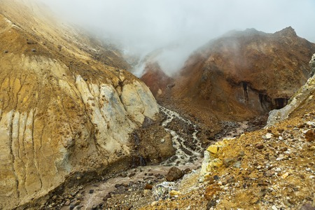 slag: Stream from the melting of glaciers on the active volcano Mutnovsky.