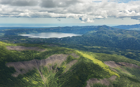 Crater Karymsky Lake. Kronotsky Nature Reserve on Kamchatka Peninsula. View from helicopter.