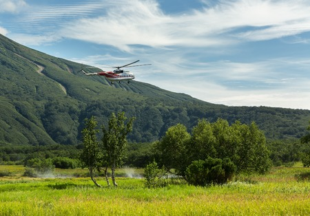 Kamchatka Peninsula, Russia - August 13, 2016: Tourist helicopter landed near the Khodutkinskiye hot springs. South Kamchatka Nature Park. View from the helicopter.
