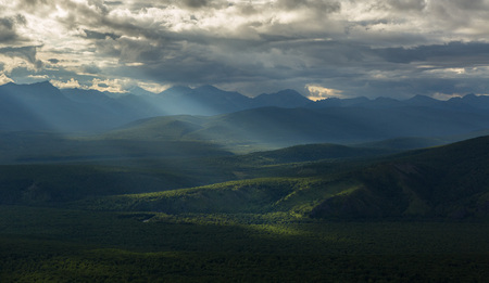 hot temper: Evening rays on Kronotsky Nature Reserve in Kamchatka Peninsula. View from helicopter.