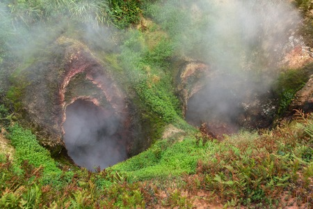 erupting: Vrata Ada Gate of Hell Geyser in Valley of Geysers. Kronotsky Nature Reserve on Kamchatka Peninsula.