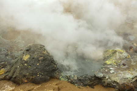 seething: Seething cauldron of boiling water in the crater of Mutnovsky volcano.