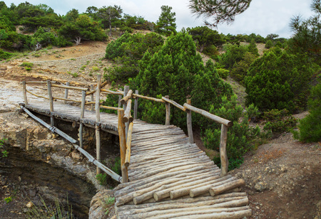 azov: Wooden bridge on Trail Golitsyn - Falcon Path a mountain pathway carved at the side of Koba-Kaya. Crimea