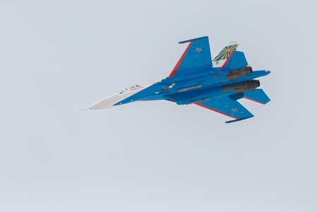 manoeuvre: Omsk, Russia - March 19, 2016: Fighter Sukhoi Su-27 in the airshow Russian Knights.