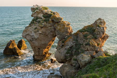 Arch of large stones in the Sea of Azov on Generals beach. Karalar regional landscape park in the Crimea.