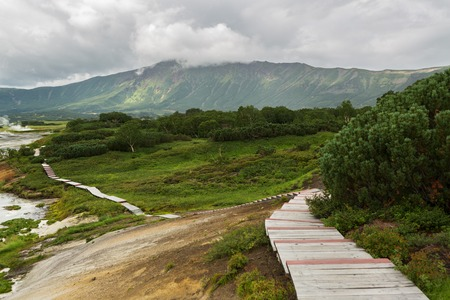 hot temper: Wooden path in the Uzon Caldera. Kronotsky Nature Reserve on Kamchatka Peninsula.