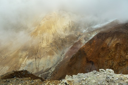 erupting: Stream from the melting of glaciers on the active volcano Mutnovsky.