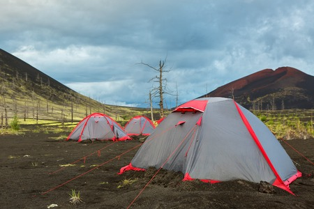 consequence: Tourist tent in Dead wood - a consequence of a catastrophic release of ash during the eruption of the volcano in 1975 Tolbachik